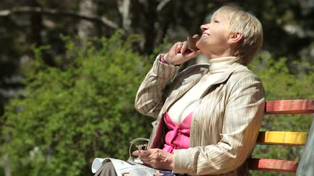 positive ageing : Happy Senior Woman On The Phone Stock Footage