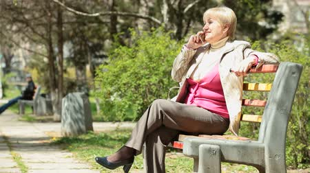 positive ageing : Smiling Senior Woman On The Phone Stock Footage