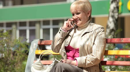 positive ageing : Cheerful Senior Woman On The Phone Outdoors