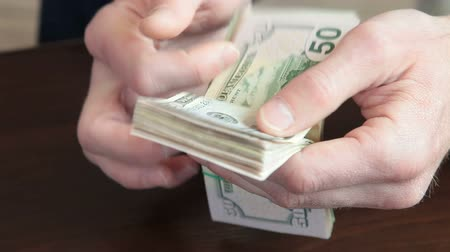 dolar : Male Hands Fast Counting US Dollars