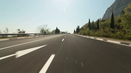 asphalt road : Driving car on coastal mountain road in direction of Yalta - Sevastopol
