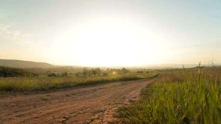 şafak : Morning rural landscape at sunrise, wide-angle lens, surface level.