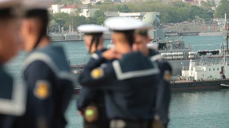donanma : Russian sailors crew, in the background moored missile cruiser Moscow. Celebration of the 230th anniversary of the Russian Black Sea Fleet in Sevastopol