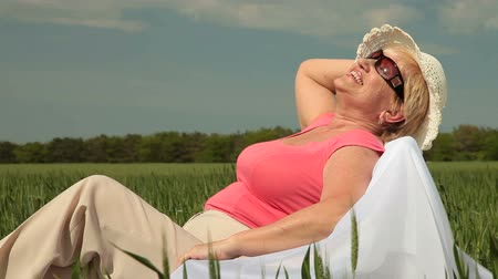 positive ageing : Attractive senior woman enjoying retirement Stock Footage