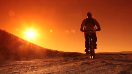 cyclists : Man Cycling at Sunrise