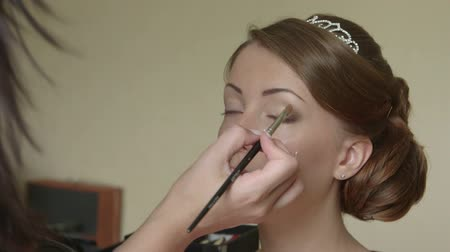 eyeshadow : Bride getting face make up Stock Footage