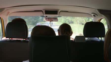 řidič : Small group of tourists on minivan trip passing through countryside