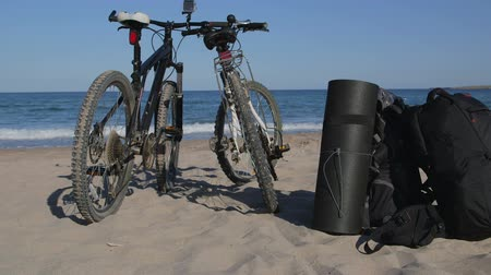 rota : Two bikes with backpacks on the summer beach