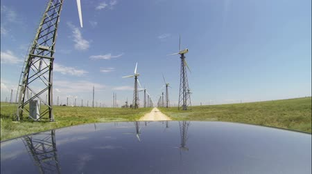 droga : Driving car through wind turbine farm, camera mounted on the roof, POV, GoPro Hero3 BE