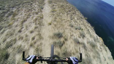 rota : Riding mountain bike on rocky seashore track, POV, GoPro Hero3 BE