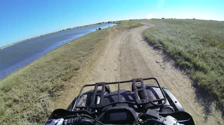 quadbike : Riding quad bike on the dusty trail POV