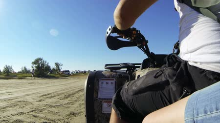 quadbike : Couple riding quad bike on the sandy beach Stock Footage