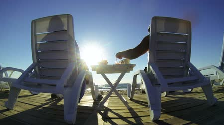 deck chairs : Couple enjoying summer beach vacation at sunset GoPro Hero3 BE