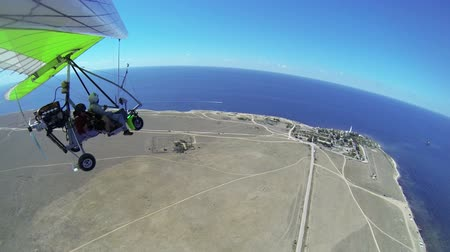 glide : Flying on motorized hang glider over sea coast GoPro Hero3 BE