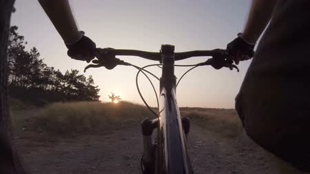 cyclists : Cyclist riding mountain bike at sunrise