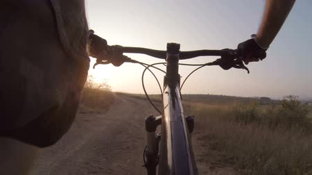 bicycle : Onboard camera: Riding mountain bike at sunrise Stock Footage