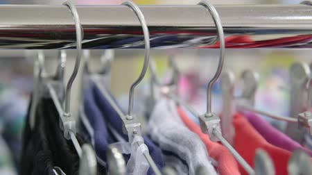 bez : Clothes on Hangers at Clothing Store, Tracking Shot