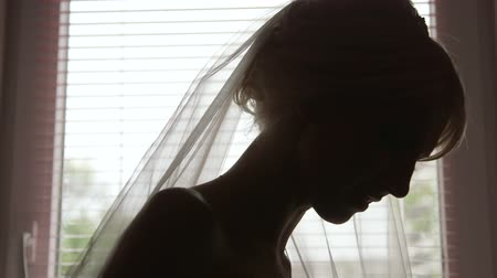 weddings : Beautiful bride silhouette preparing for wedding Stock Footage