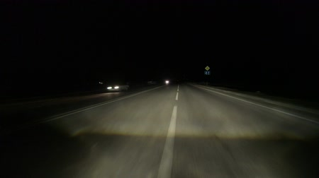 night : Drive on dividing strip at night POV Stock Footage
