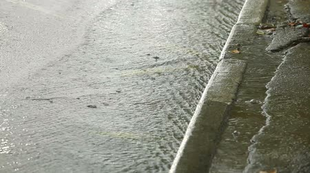 asfalto : Flow of rain water on  city street