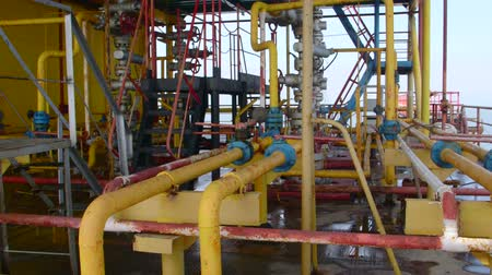 exploration : Offshore gas and oil production platform series of pipes, gauges and valves