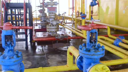 detail : Offshore gas and oil production platform series of pipes, gauges and valves in the East-Kazantip field, pan shot