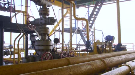 rigs : Offshore gas production platform components series of pipes, gauges and valves pan shot Stock Footage