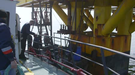 rigs : Sea of Azov, Crimea - March 28, 2014: Staff members are transported by ship for a two-week shift at offshore gas production platform in the East-Kazantip field