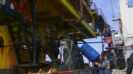 rigs : Sea of Azov, Crimea - March 28, 2014: Staff members are transported by ship for a two-week shift at offshore gas and oil production platform in the East-Kazantip field Stock Footage