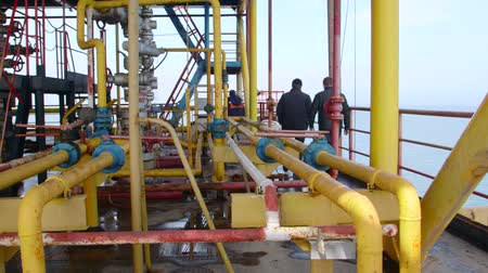 rigs : Sea of Azov, Crimea - March 28, 2014: Staff members at offshore gas production platform in the East-Kazantip field