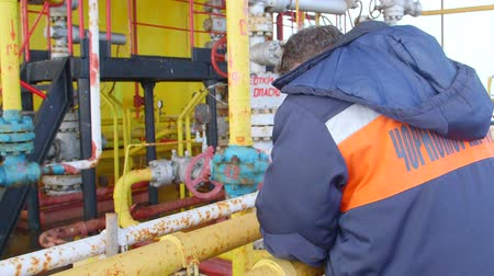 natural resource : Sea of Azov, Crimea - March 28, 2014: Engineer working on offshore gas and oil production platform in the East-Kazantip field