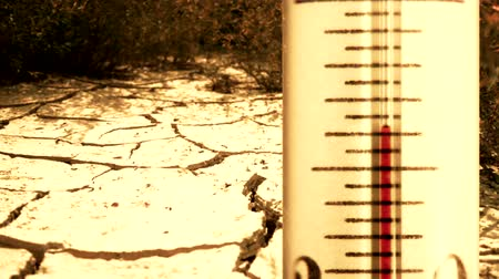 gerekçesiyle : Fast rising temperature on the thermometer, large cracks in ground during dry season at background
