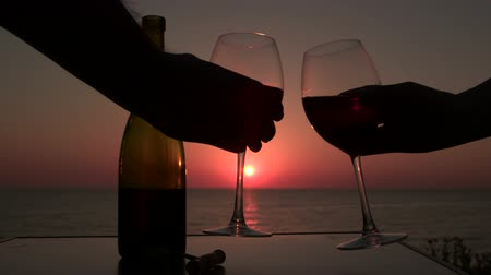 alcohol : Man and woman clinked glasses with red wine at sunset Stock Footage