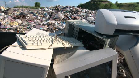 elektronika : Discarded obsolete computer scrap at illegal rubbish dump tracking shot