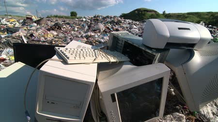elektronický : Old desktop computer parts at the garbage dump tracking shot