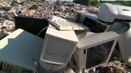 Obsolete computers at the dumping ground tracking shot Stock Footage