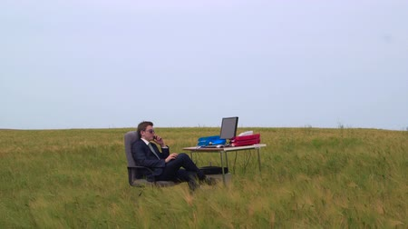 employee : Businessman on the phone in a open air virtual office