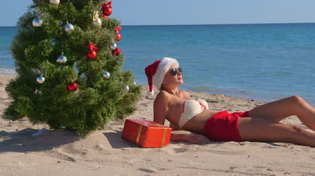 vacation destination : Girl in Santa hat enjoying Christmas vacation time on beach resort