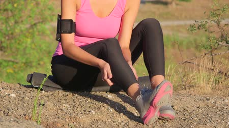 Workout fitness injuries young woman with pain in the leg muscles during exercise outdoors Stock Footage