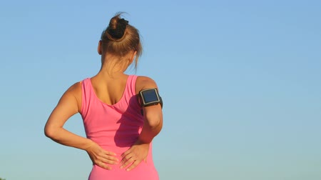 zpátky : Workout fitness injuries young woman with lower back pain during exercise outdoors