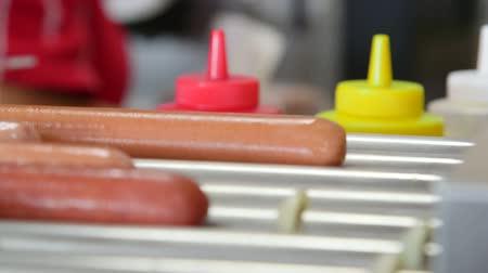 Hot dogs roller maker in hotdog diner Filmati Stock