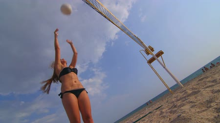 volleyball : Summer vacations recreation girl playing beach volleyball