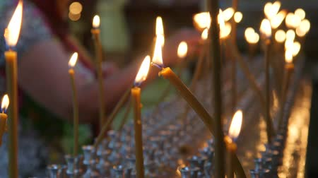 oneself : Burning prayer candles in Russian Christian Orthodox Church close-up