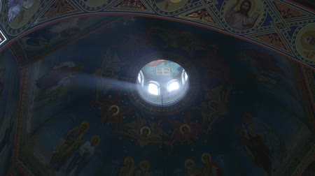 iconography : Ray of sunlight illuminates faces of saints in Orthodox Church