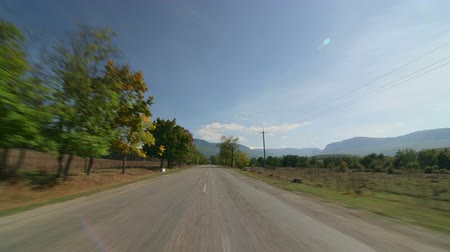 rota : Riding down the highway in direction of Crimean mountain range on the horizon POV