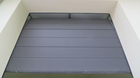 gates : Residential automatic garage door roll up on tracks across the ceiling