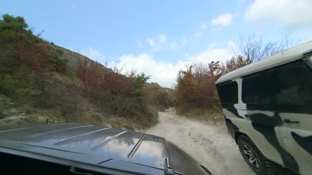 jumble : Off-road vehicle on rocky track to Mangup in the Crimean mountains
