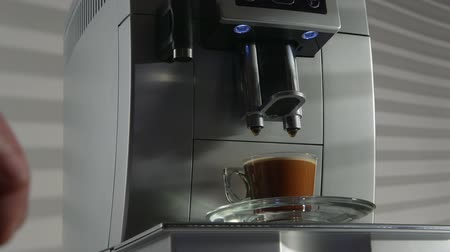 készítő : Espresso coffee machine in the office