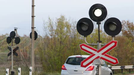 geçti : Sign of railway level crossing with flashing signal lights