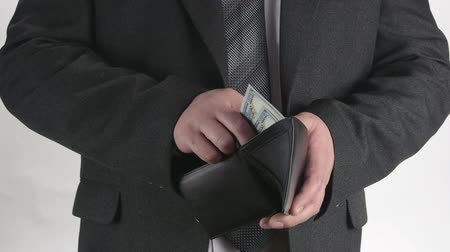 cüzdan : Business person pulling out his wallet from pocket and counting money